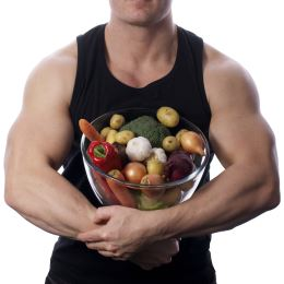 Muscular man with bowl of veggies.Size260jpg