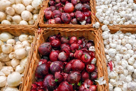 Baskets of Red and White Onions and Garlic