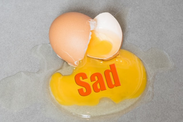Sad Cracked Egg on Counter