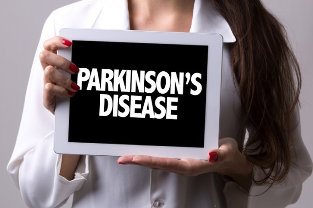 Female Doctor With Parkinson's Sign